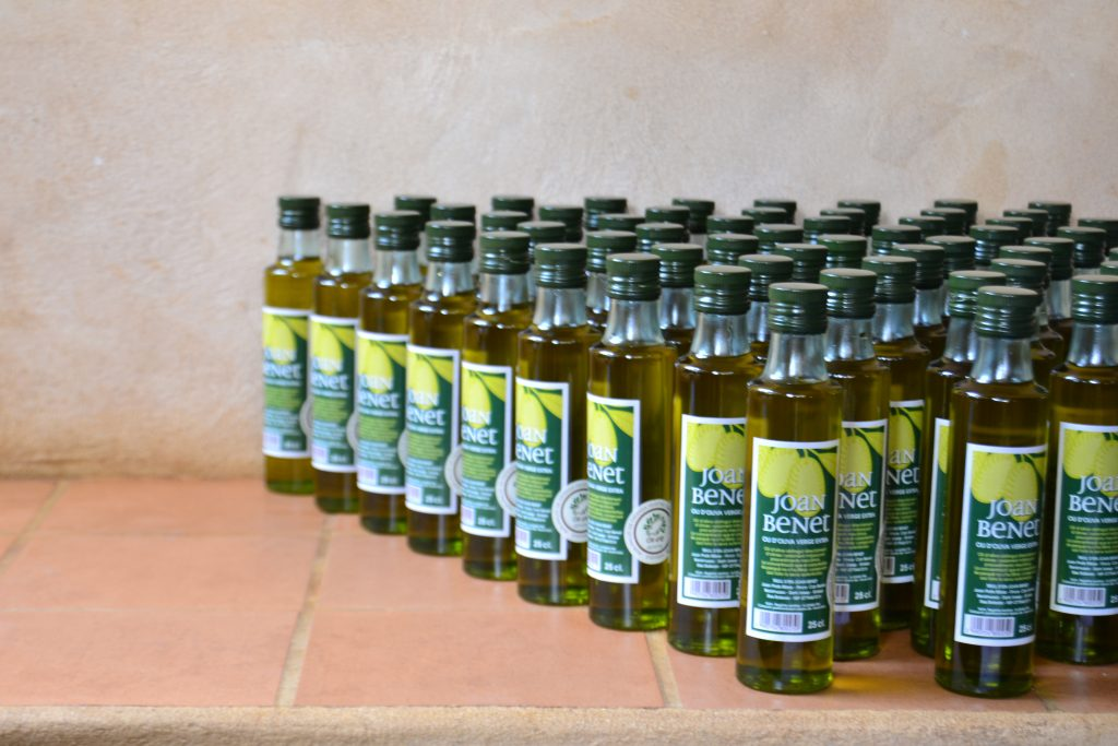 This picture shows multiple bottles of olive oil.